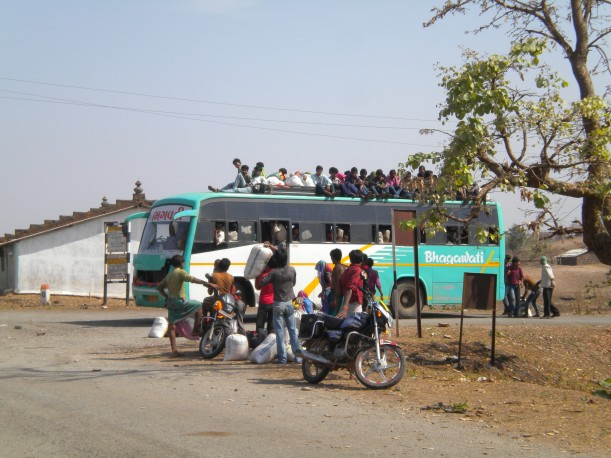 A private bus transports construction laborers to Surat from a remote village in Southern Rajasthan.